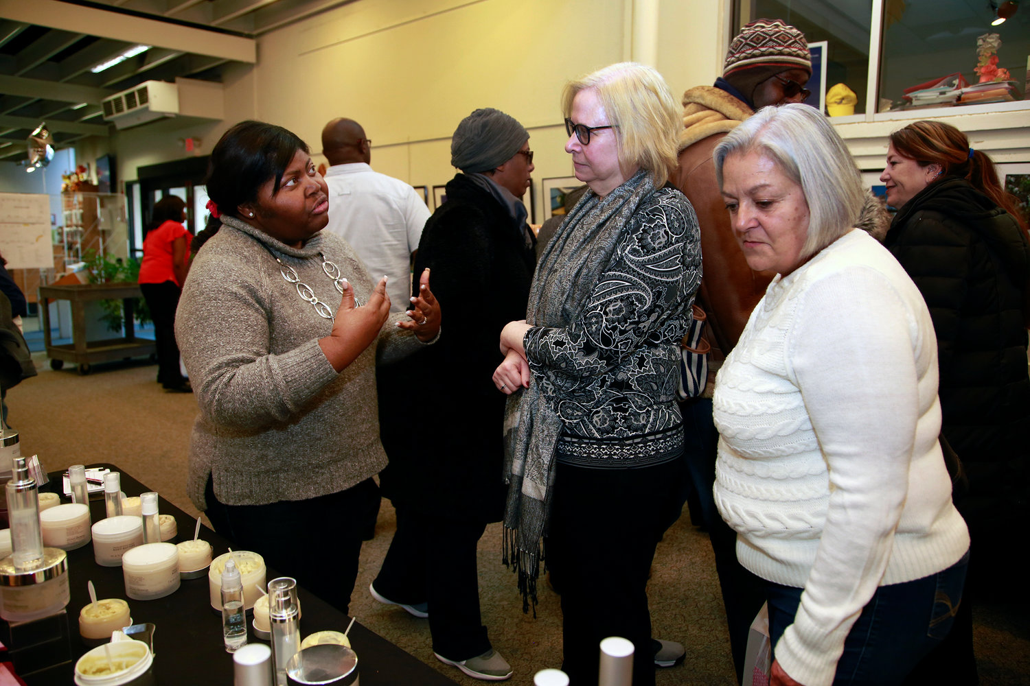 Owner of Sheago Cosmetics, Crystal Melton, left, talked to Pam Bond and Jan Heinlein, right, about her products.