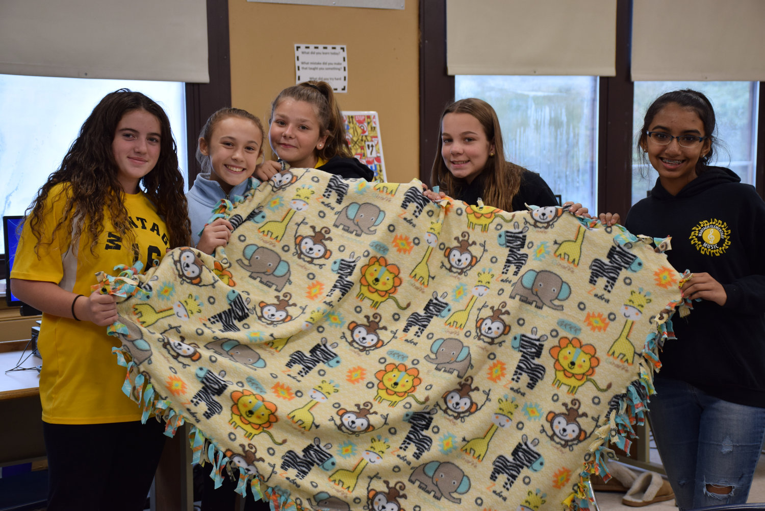 Students in Wantagh Middle School's eighth-grade business management elective made fleece blankets for the patients at Ronald McDonald House of Long Island.