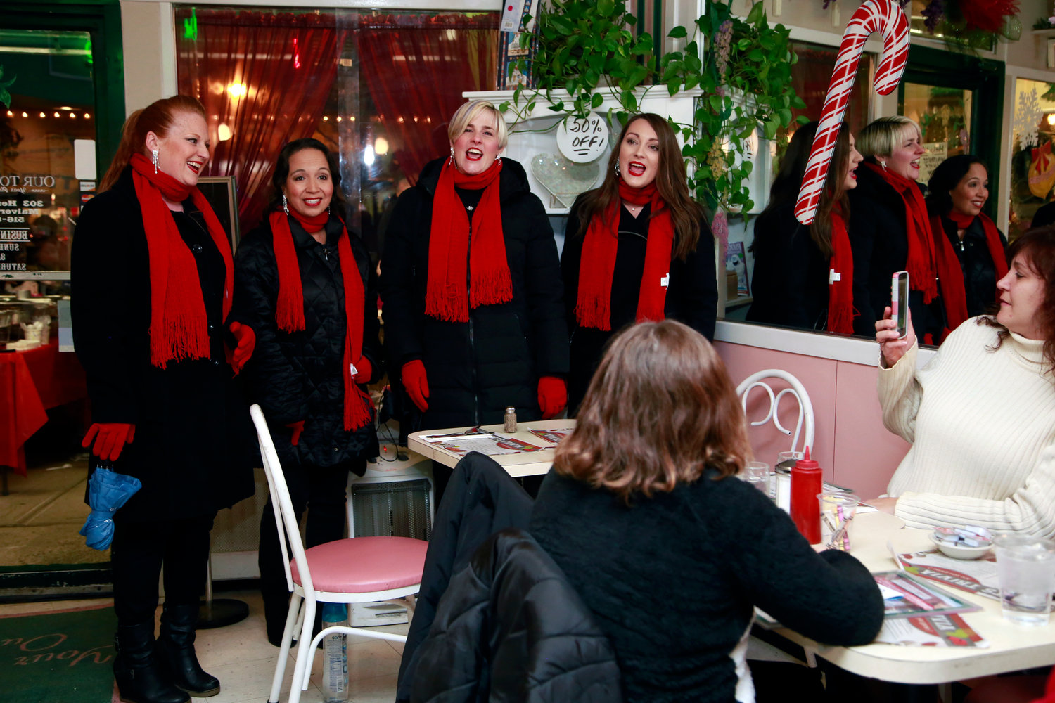 No Quarter Quartet treated patrons of Our Town to some Christmas harmonies.