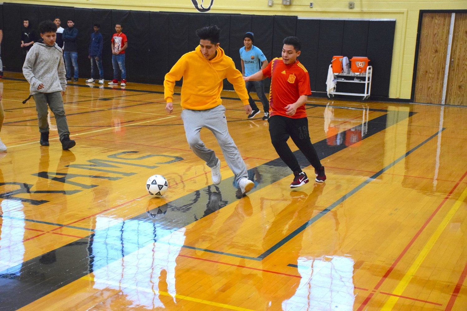 West Hempstead's ENL students played a soccer game during a Thanksgiving luncheon in the high school gymnasium.