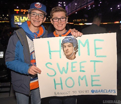 Wantagh's Seth Schlank, left, and Jake Isler created a sign with Islanders' star Mathew Barzal as the centerpiece.