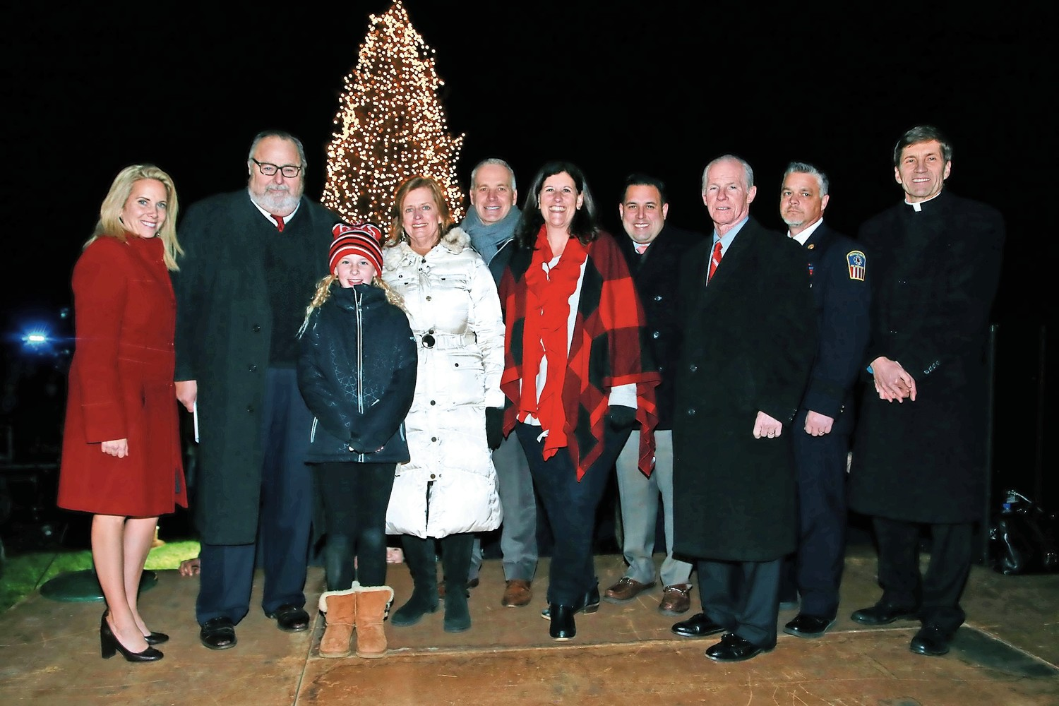 Supervisor Laura A. Gillen, Mayor Fran Murray, Watson School 5th grader Ellie Lennon, Assemblywomen-Elect Judy Griffin, Trustee Emilio Grillo, Deputy Mayor Kathy Baxley, Councilman Anthony D'Esposito, Village Justice William Croutier, Chief Brian Cook and Monsignor William Koenig.