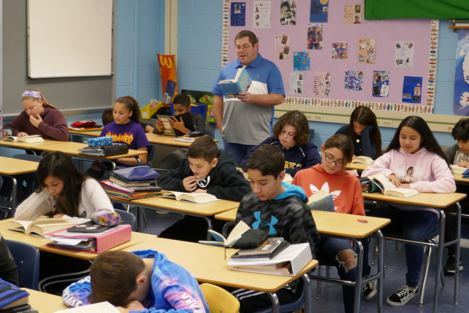 Students in Edward Risener's class at Oceanside Middle School are taking part in a schoolwide read-aloud program to help erase the stigma associated with mental health issues.