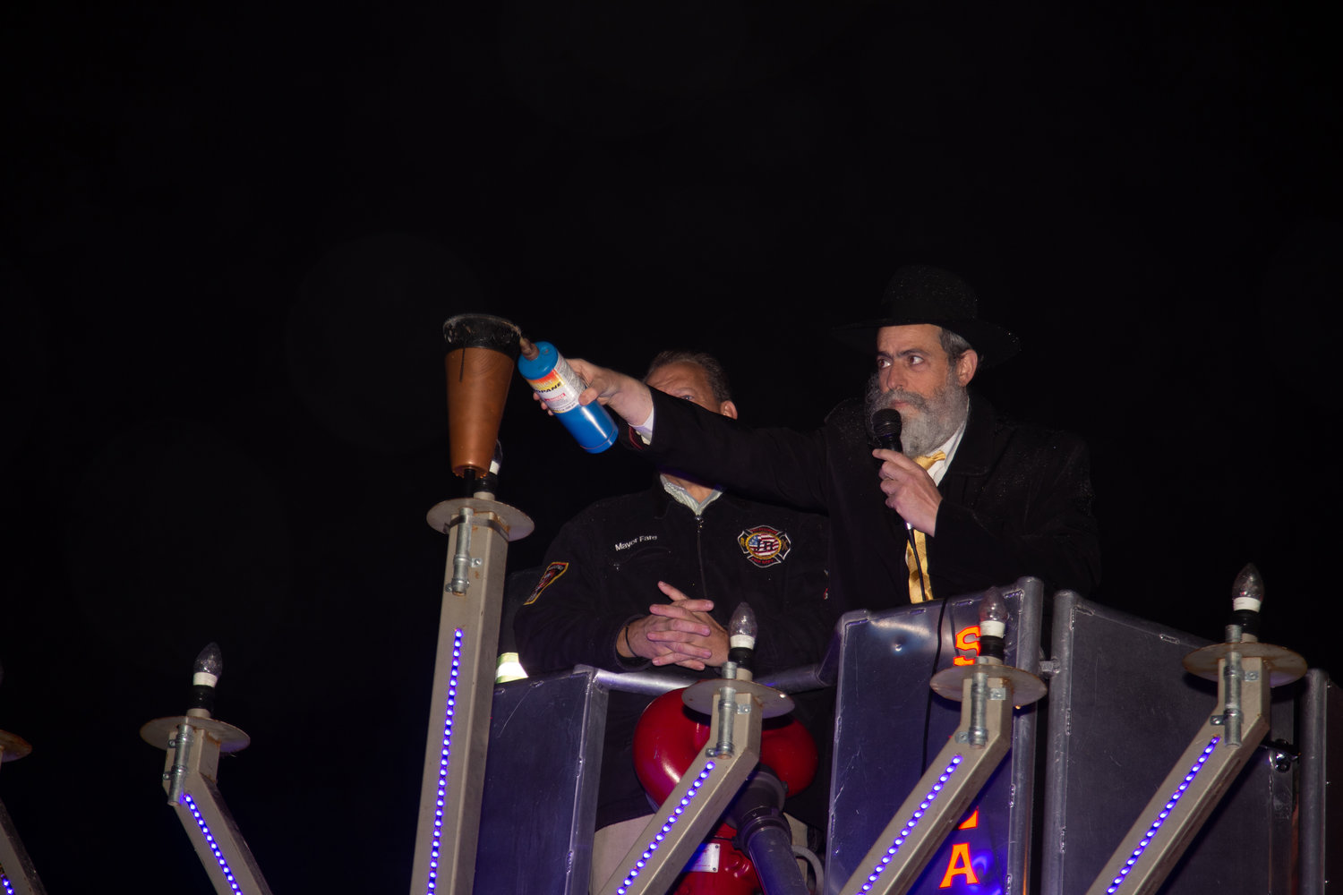 Rabbi Yitzchak Goldshmid put propane in the shamash candle, the candle that lights the others.