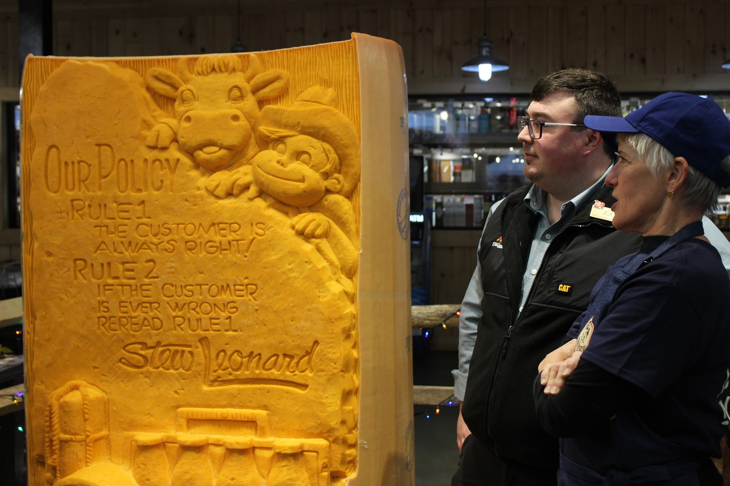 "The East Meadow Stew Leonard's is hoping to make history for hosting the creation of the world's largest cheese sculpture, if the ""Guinness Book of World Records"" confirms it. Artist Sarah Kaufmann, far right, carved the 3,462-pound aromatic work. With her was Deli Manager Joe Czel."