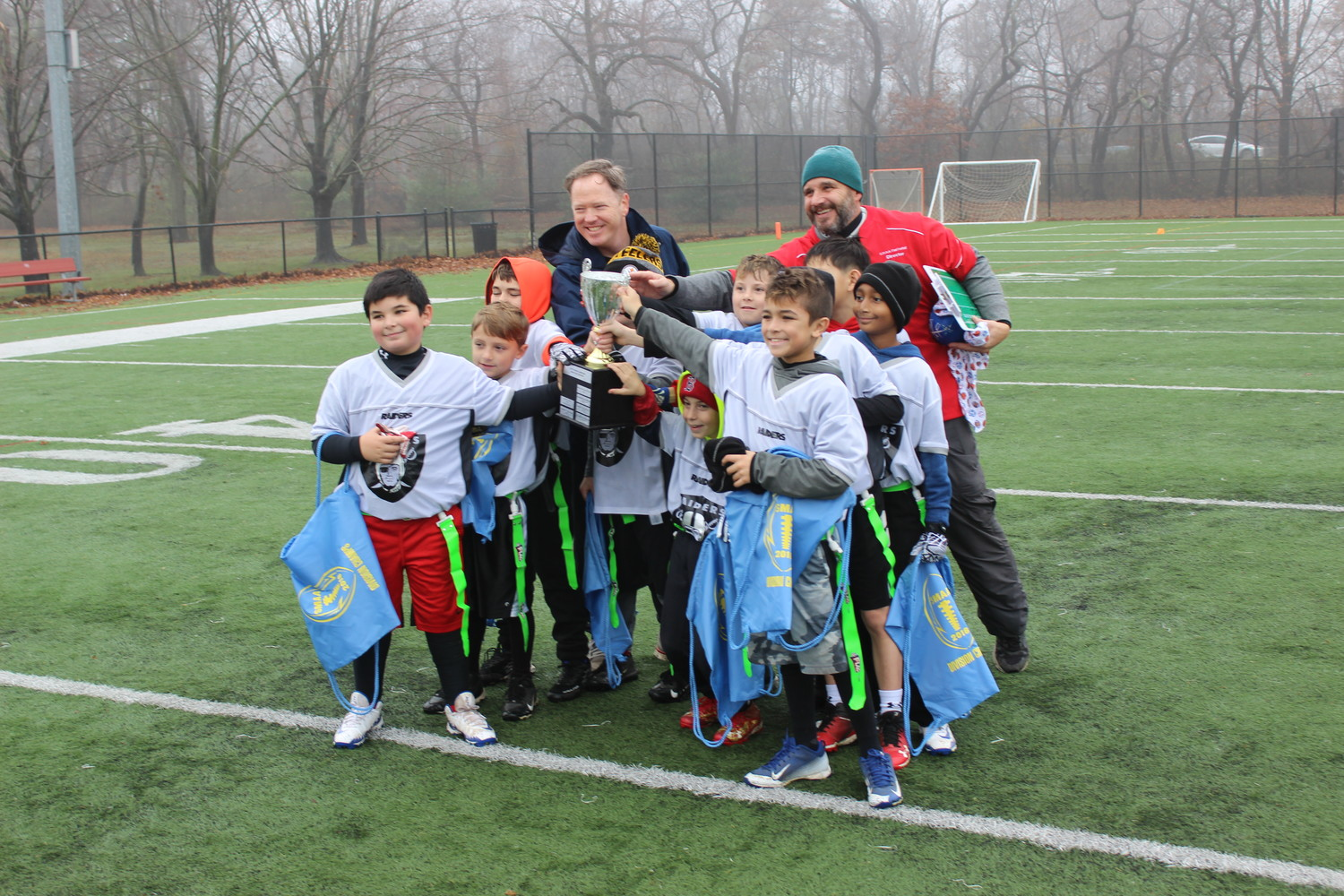 "The ""Raiders"" beat the ""Colts"" in the third and fourth-grade division of the SMAA Flag Football league championship finals."