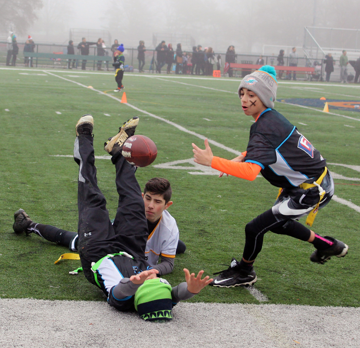 Athletes on both sixth and seventh-grade teams leapt forward to save the football before it went out of bounds.