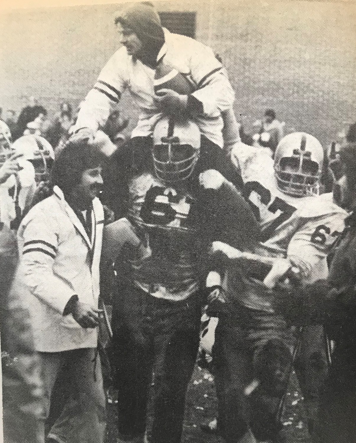 Oceanside varsity football players triumphantly carried coach Roy Kessenich after winning the Nassau County Conference I championship in 1977.