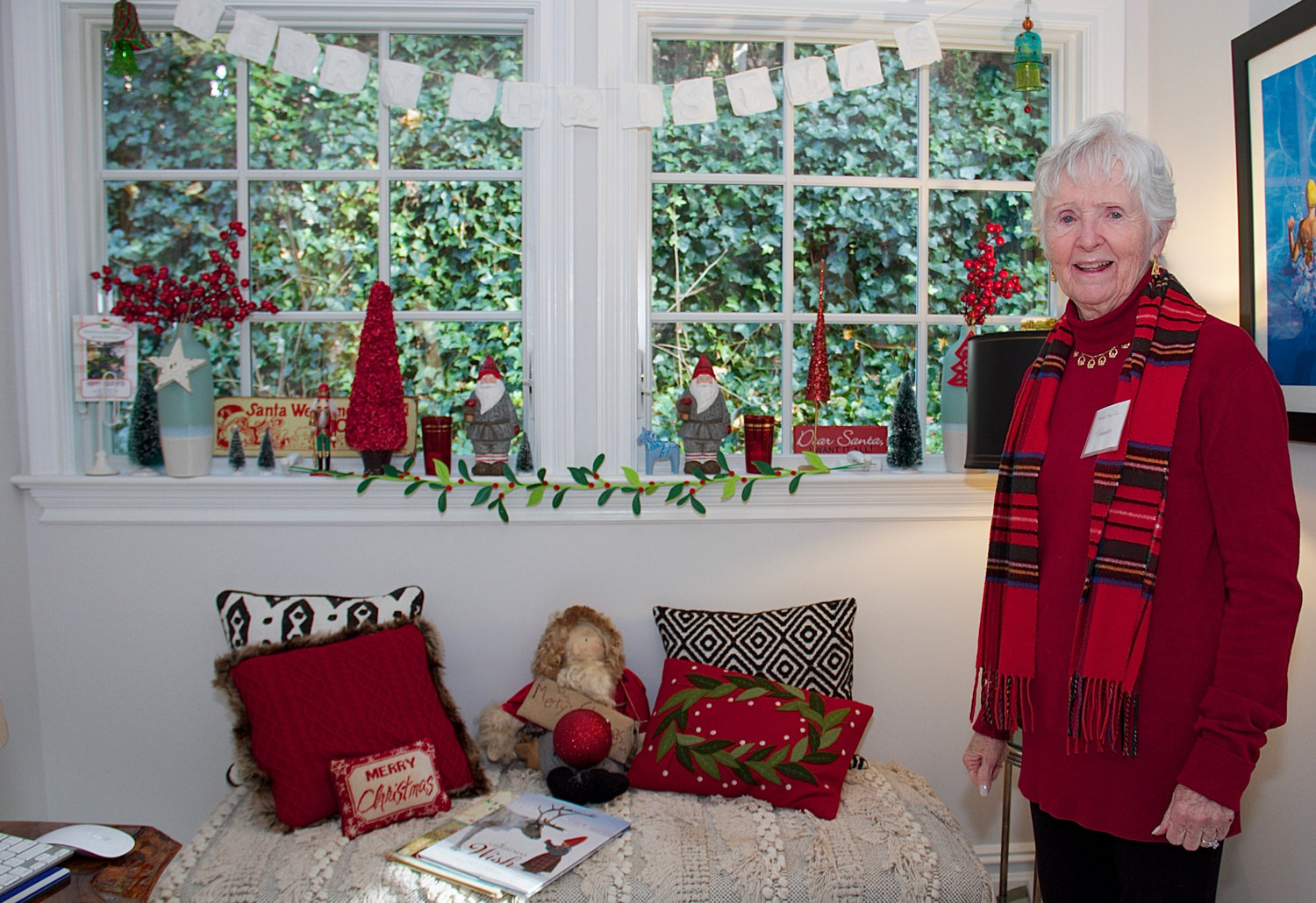 Docent Maureen Maddock greeted guests who visited Jane McGilloway's seaside cottage, which featured a festive window display.