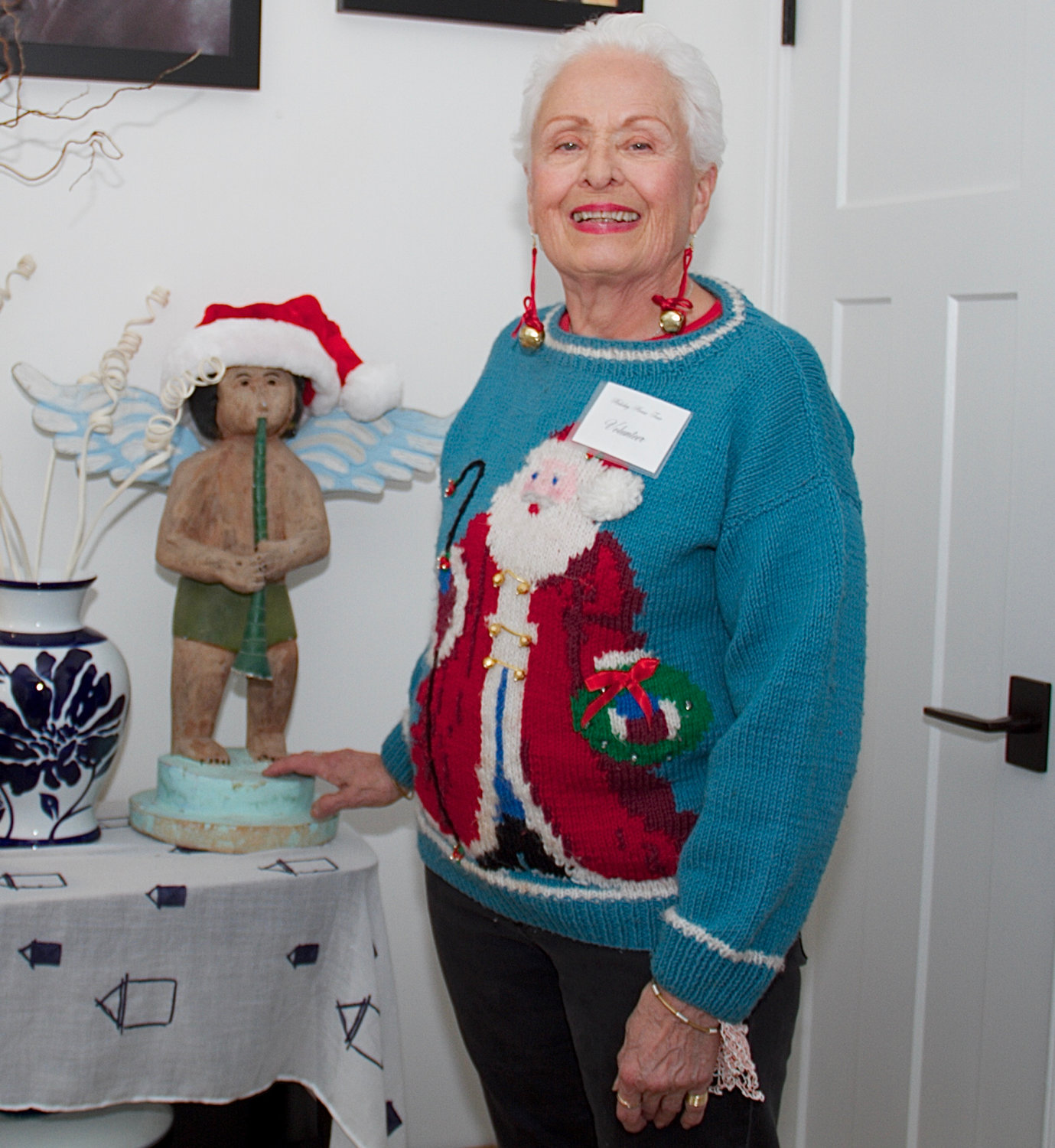 Volunteer Robbie Nuttall spread holiday cheer with her jingle bell earrings and Santa sweater.