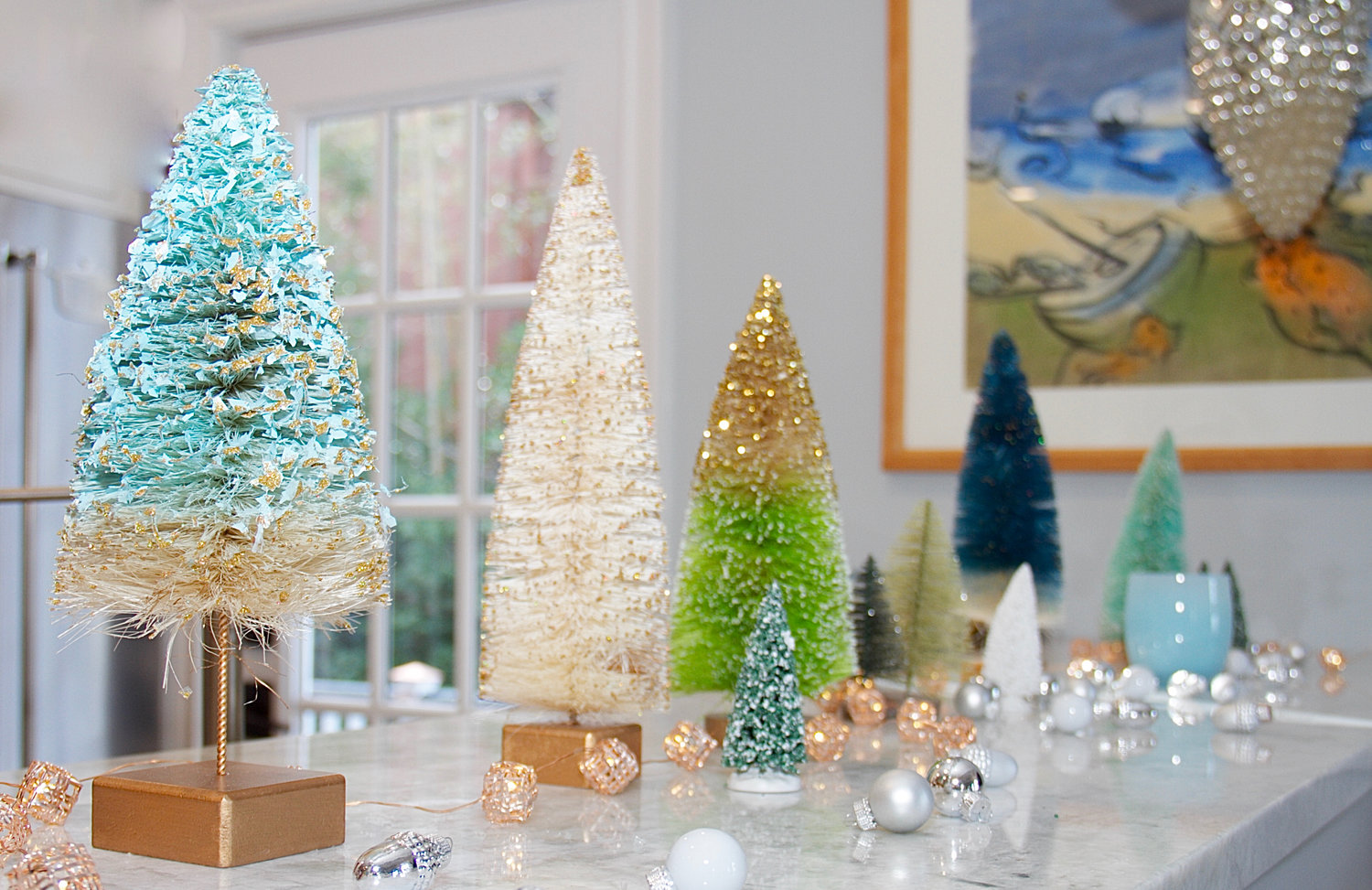 A miniature forest of gold Christmas trees added a touch of seasonal sparkle to Jane McGilloway's modern kitchen.