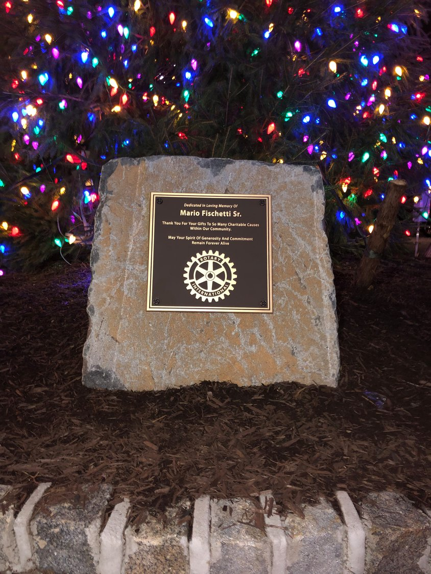 A golden plaque at the base of the tree was dedicated in memory of former business owner Mario Fischetti Sr., of Glen Head, who died in 2016.