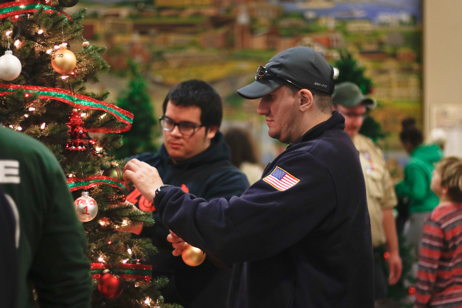 Freeport Fire Department members decorated their tree with lights, ribbons and personalized ornaments. Fire fighter Albeiro Gonzalez, from Vigilant Hose Company No. 2, worked added ornaments to the tree.