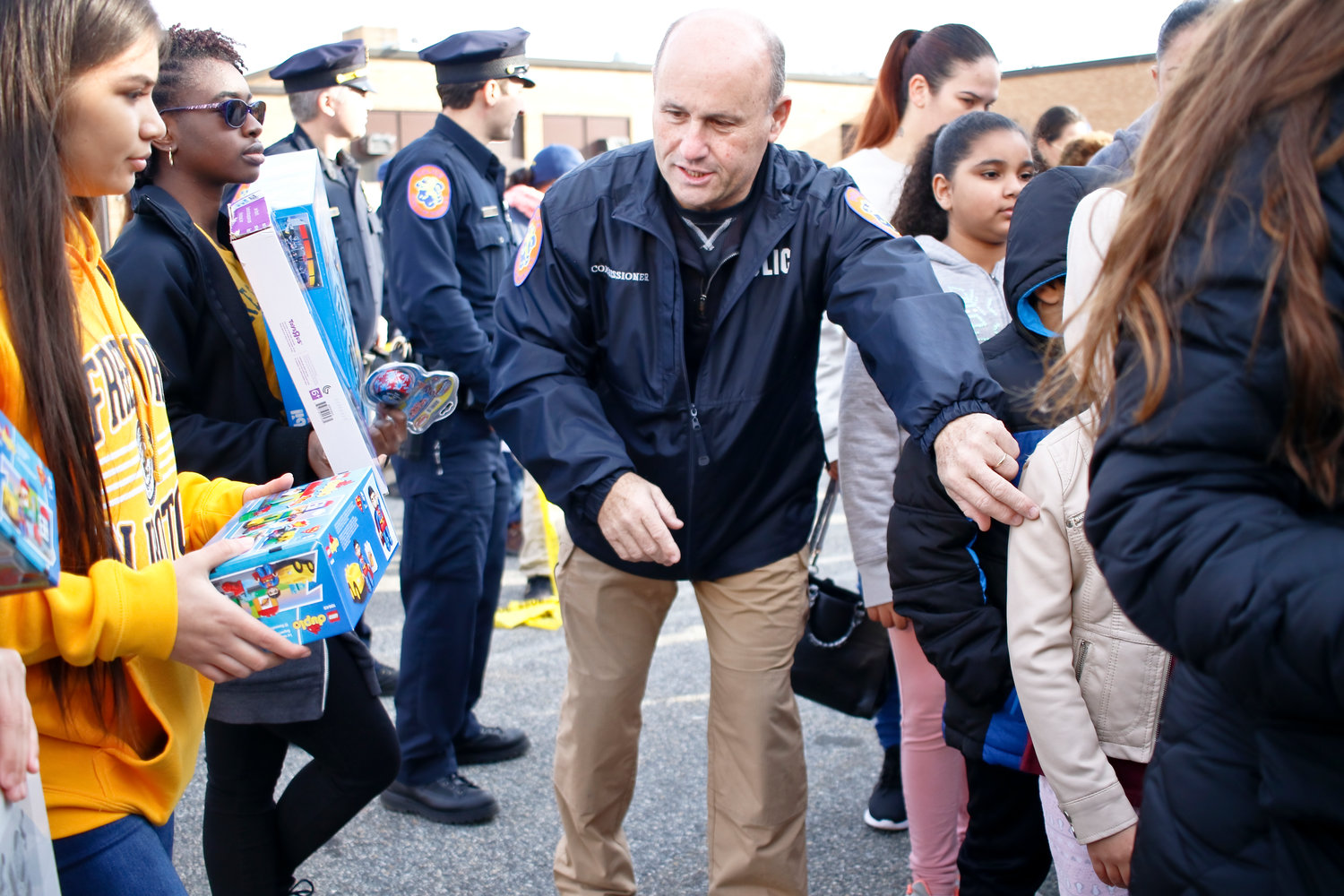 Police Commissioner Patrick Ryder helped hand out toys to the hundreds of children gathered at Freeport High School.