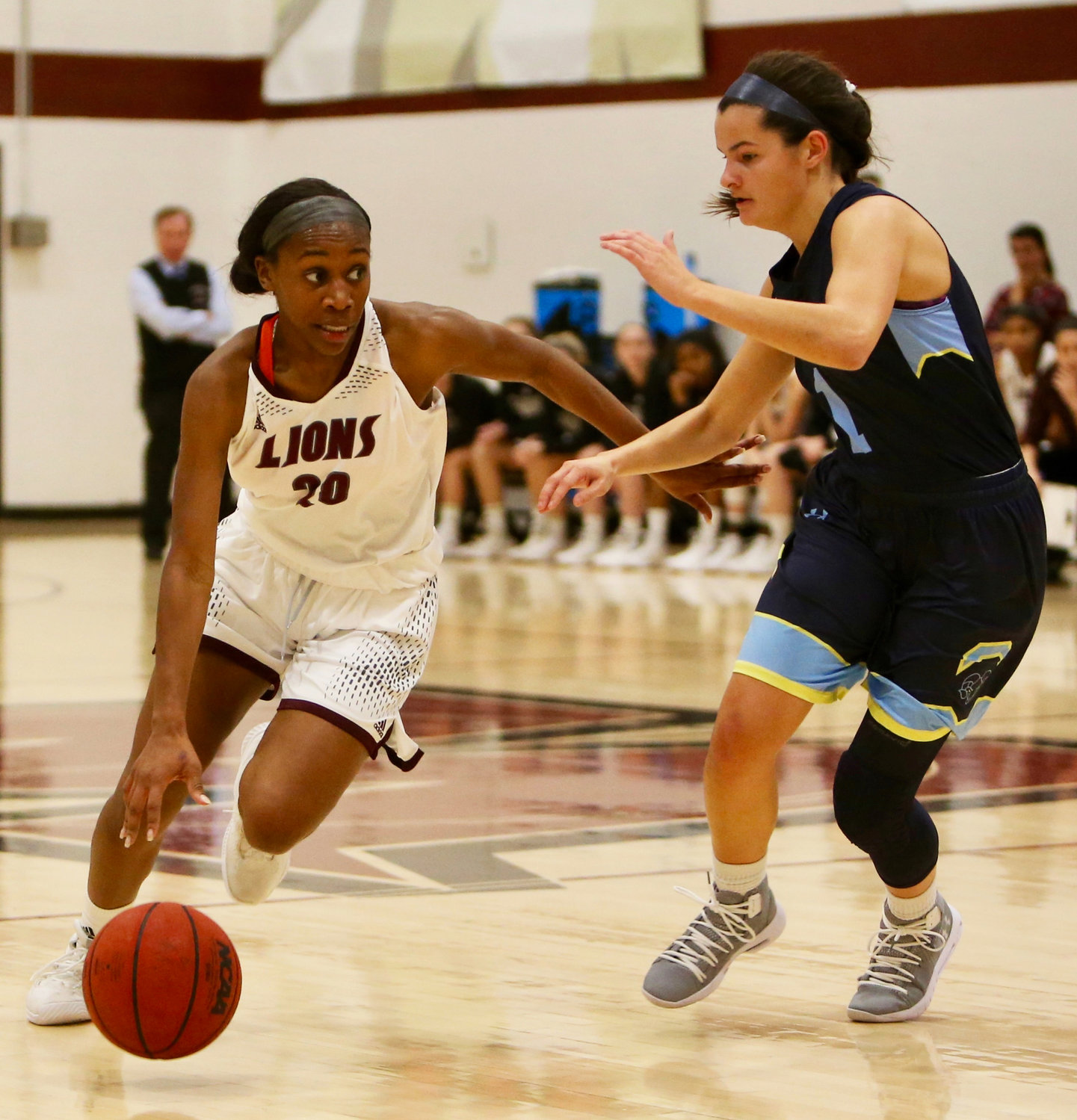 Tyra Harrison, left, is a former Baldwin High School standout playing her final season of NCAA eligibility at Molloy after spending two seasons at SUNY Farmingdale.
