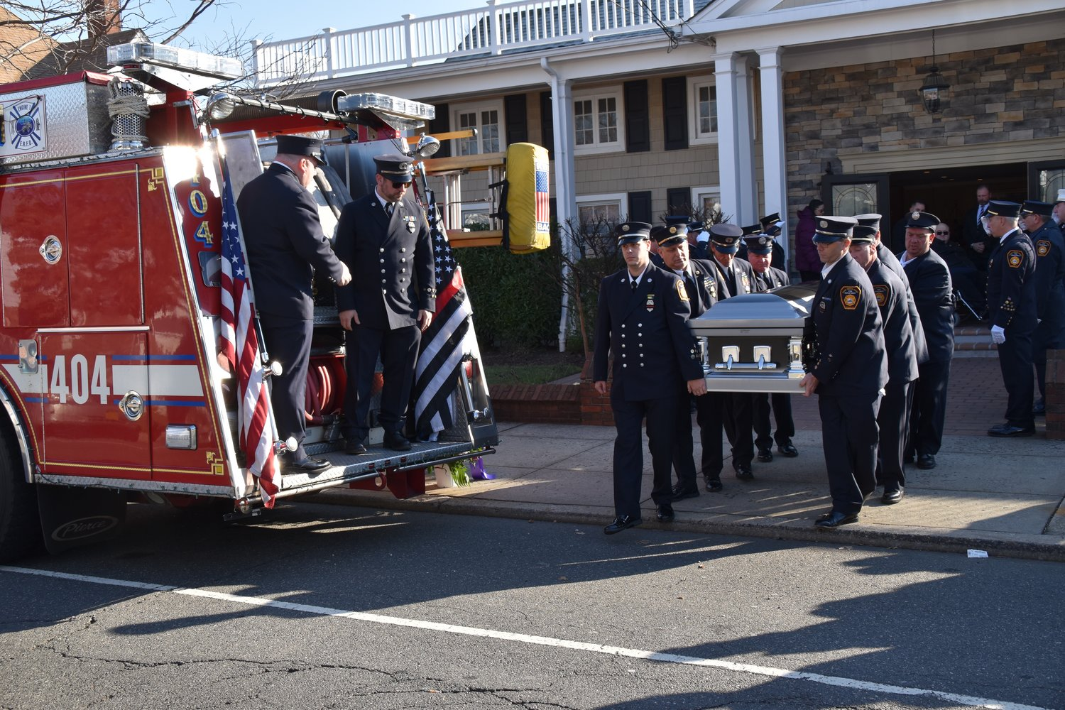 On Tuesday, dozens of firefighters attended the funeral service of former East Rockaway Fire Chief Gene Torborg at Perry Funeral Home.