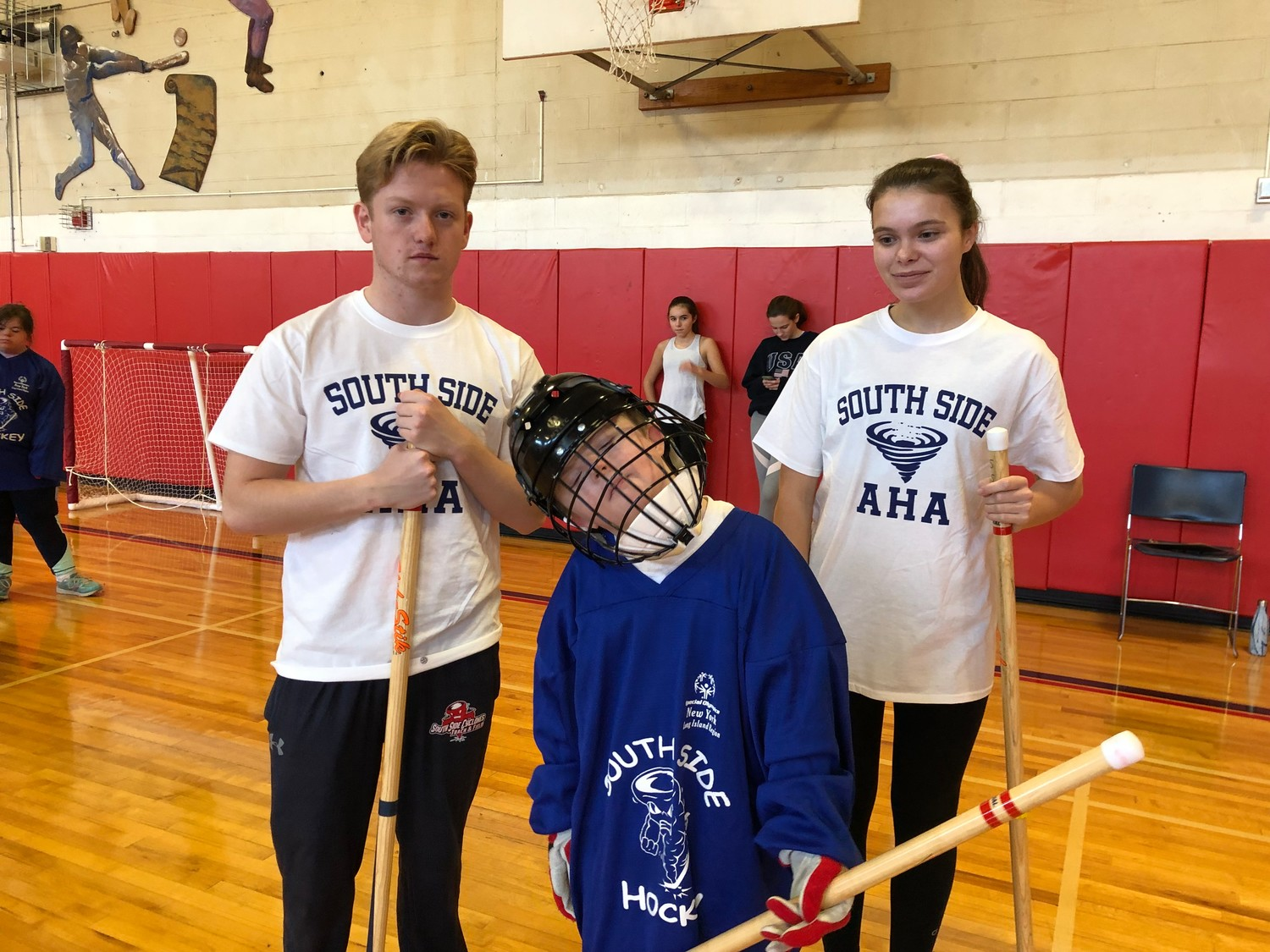Brian Heaney, center, joined Athletes Helping Athletes volunteers Jack McGowan and Caitlin Cuszak.