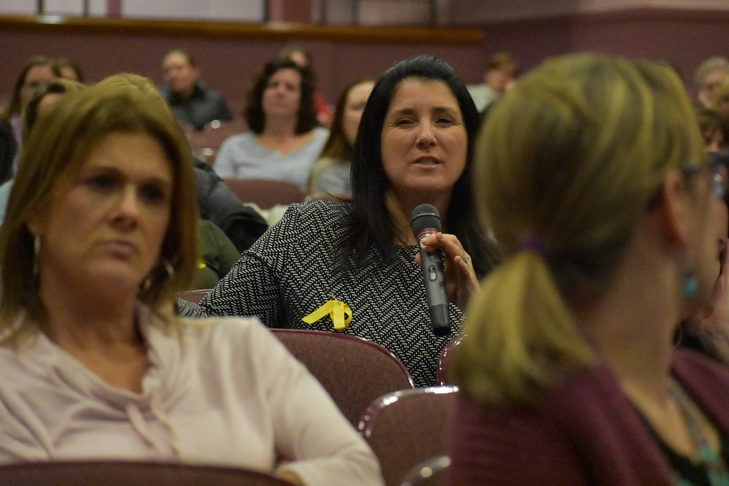 Karen Burgie, holding microphone, a Special Education Partners representative, was among dozens of parents at the Board of Education meeting on Dec. 5.