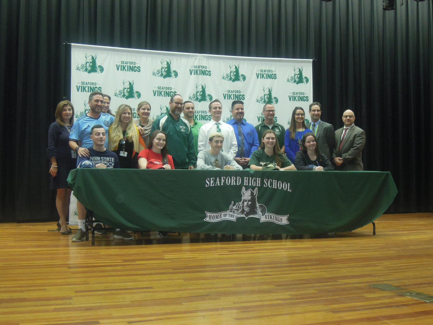 Seaford athletes with their guidance counselors and coaches.