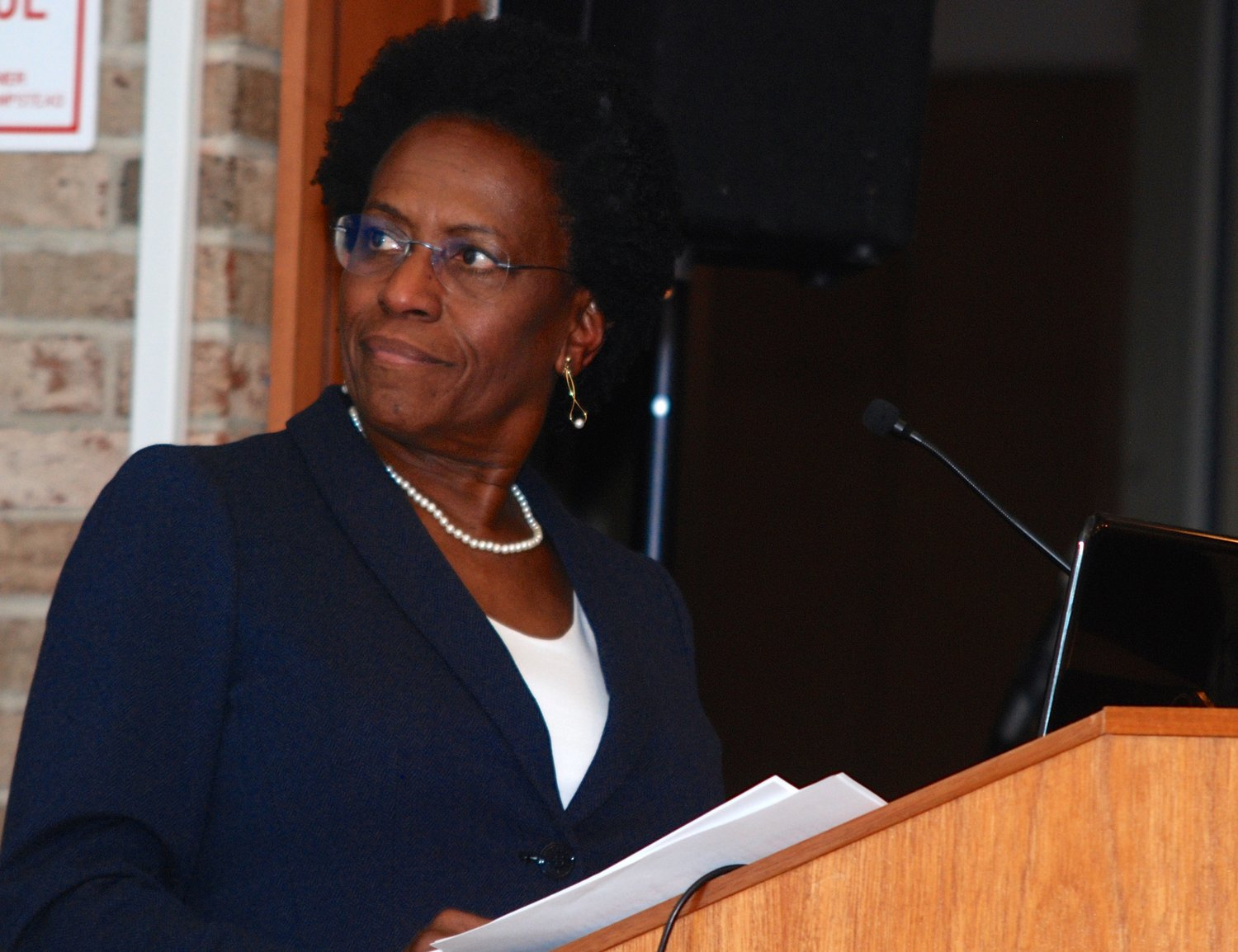 Elaine Gross, president of ERASE Racism, addressed a diverse audience at a Dec. 5 panel discussion at Hofstra University to address structural racism on Long Island. It was one of five such talks intended to encourage a larger, ongoing conversation.