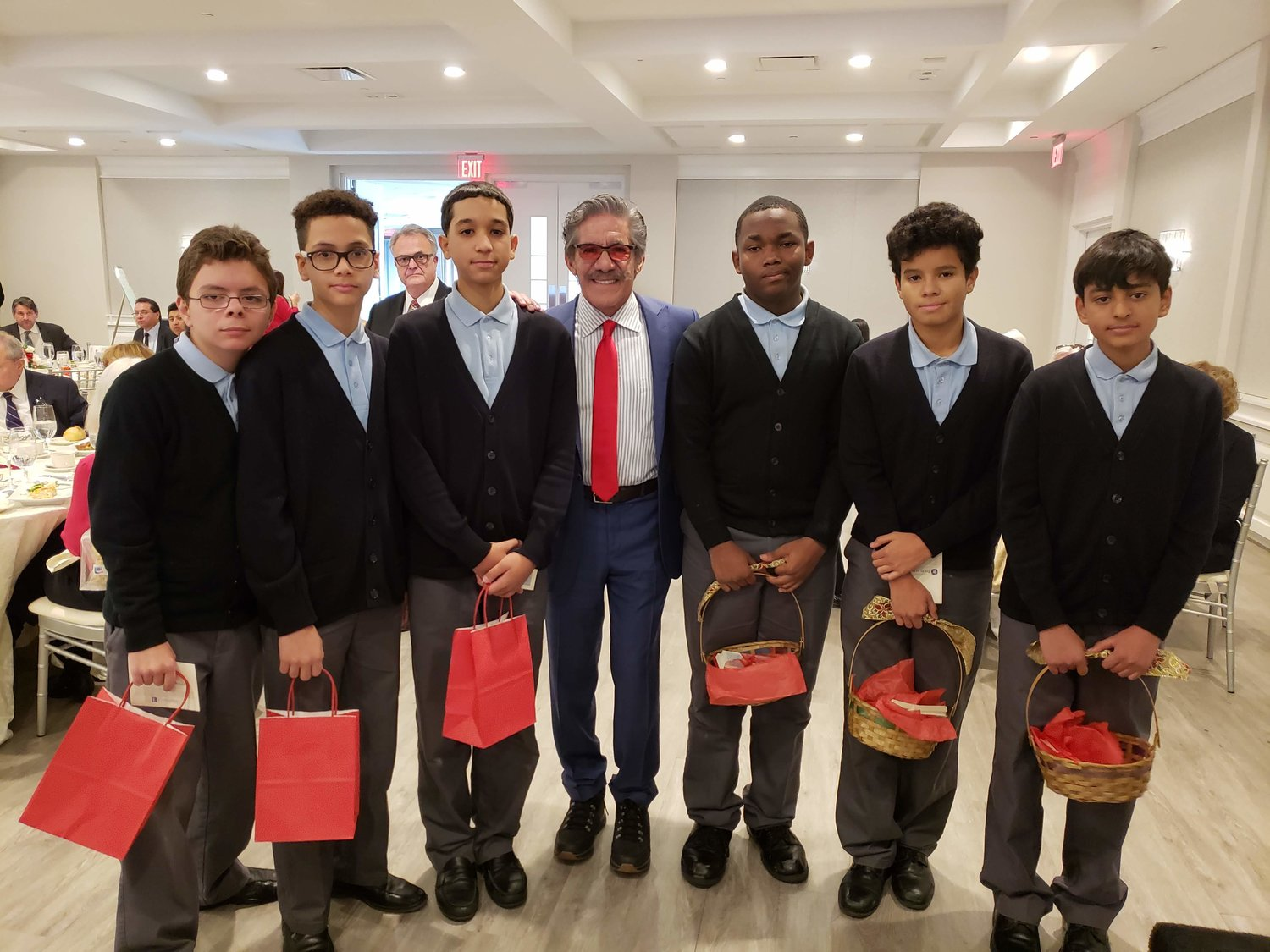Journalist and talk show host, Geraldo Rivera, center, met with students from the De La Salle School on Dec. 6 at the Engineers Country Club in Roslyn Harbor during the school's annual Christmas Luncheon.