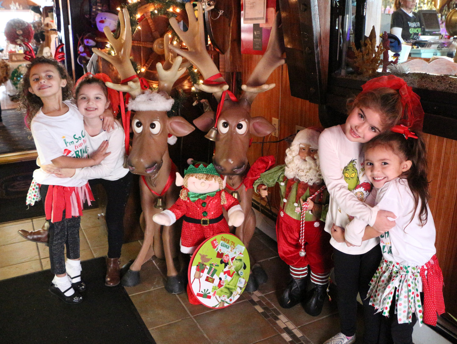 It's a girl's day out at Otto's Sea Grill for Sofia Flores, 6, left, Emma Carroll, 6, Ava Carroll, 7 and Gia Flores, 7 where they planned to meet to the Grinch.