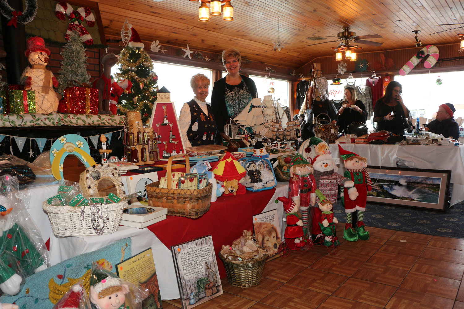 During Otto's Sea Grill Holiday Boutiques, Rosemarie Mag, left, and Illona Jagnow, owner of Otto's, sold creative Sea Shore Holiday Crafts.