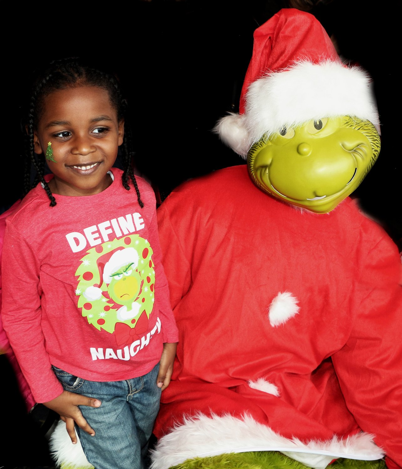 Aamir Bowman, 4 took a quick picture with the sneaky Grinch.