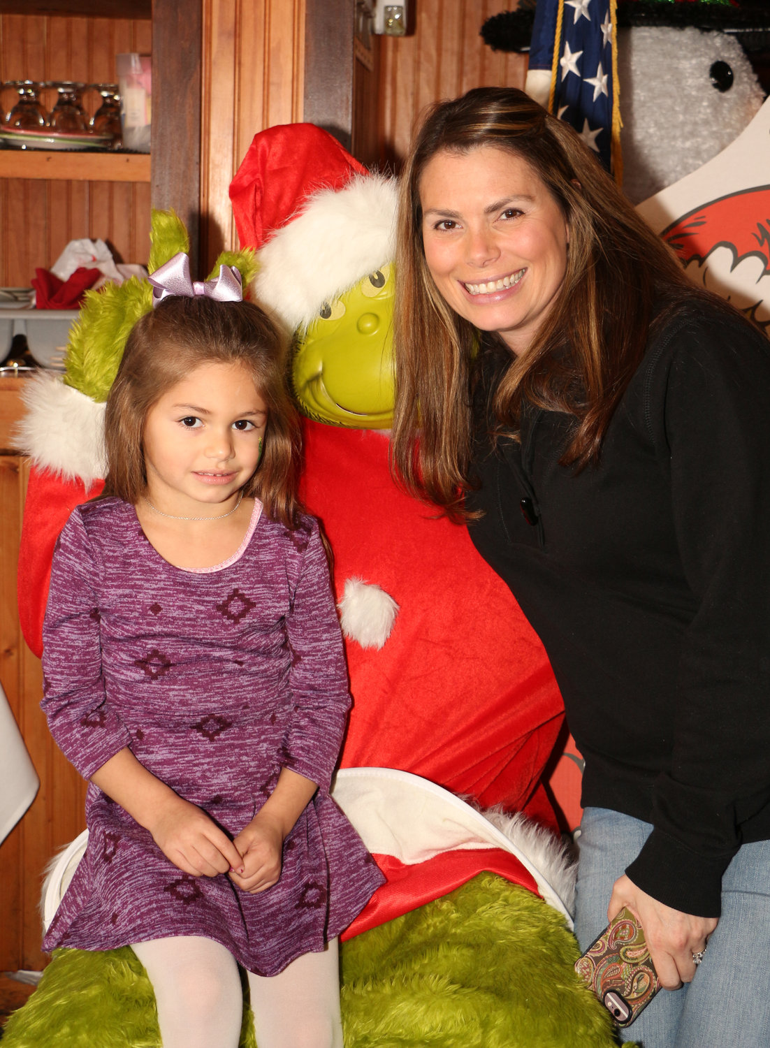 Averi Murnane, 4, and her mom Cheryl Murnane hung out with the Grinch after lunch.