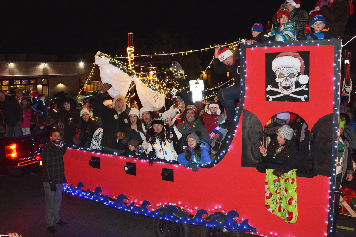 City Council President Anthony Eramo awarded the Wyoming Avenue Pirate Ship with a trophy on Saturday during the Electric Light Parade on West Beech Street, where more than 75 cars, fire trucks, floats and bikes were wrapped with thousands of lights that illuminated the West End.