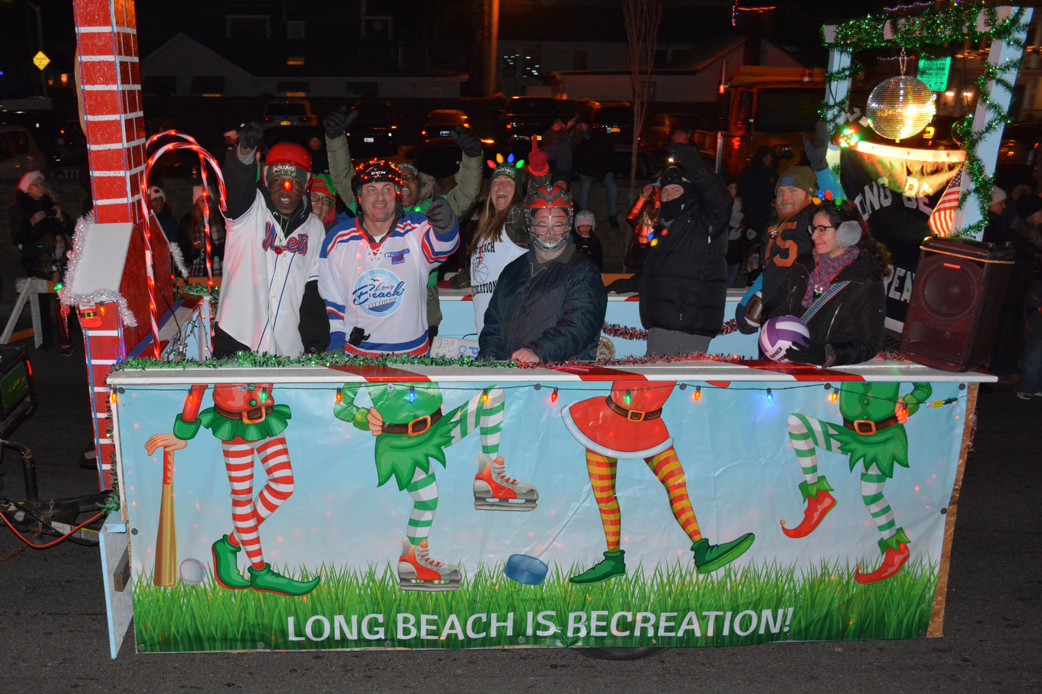The Rec's float was among the more than 80 antique cars, fire trucks, floats and bicycles decorated in festive holiday lights made their way down the parade route from Ohio to New York avenues.