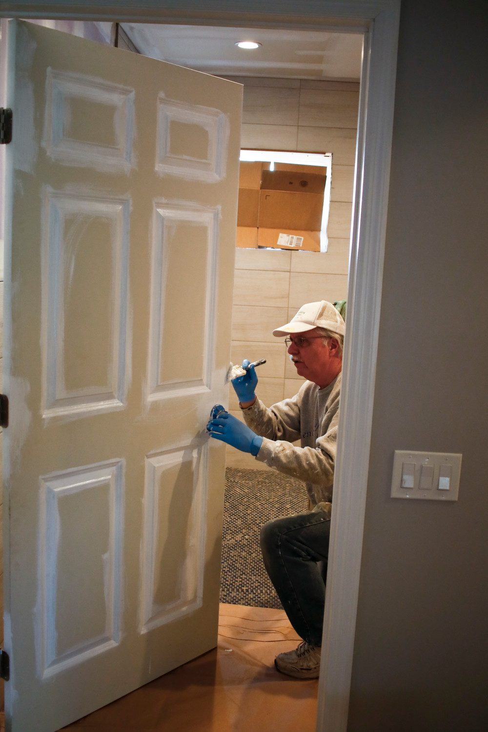 Rebuilding Together Long Island volunteer Dennis Franco painted the bathroom door.