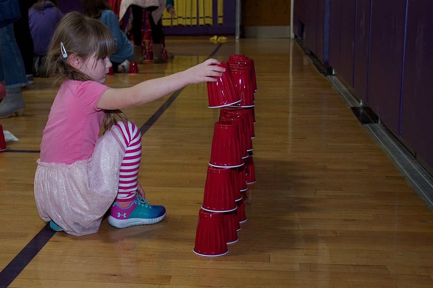 Lucille Kelly, 5, learned that stacking cups was not easy.