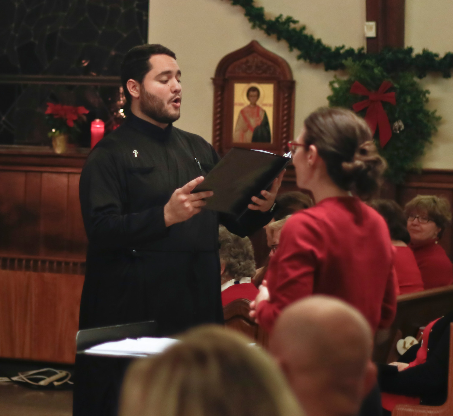 "Saint Vladimir soloist Phillip Ritchey sang the tenor solo in ""What Shall We Offer Thee?"""