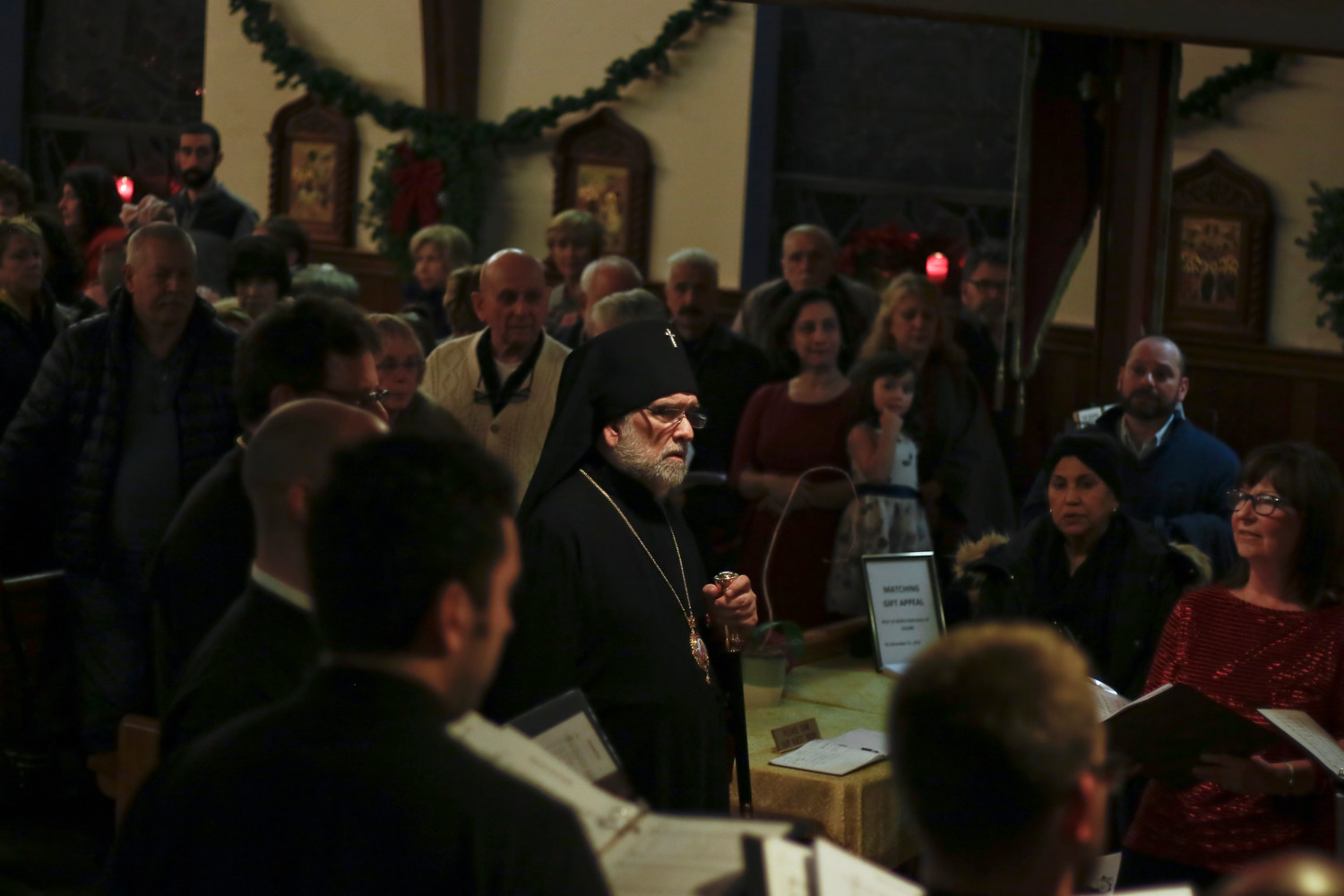 His Eminence Archbishop Michael Dahulich, of the Diocese of New York and New Jersey, joined the audience in singing carols.