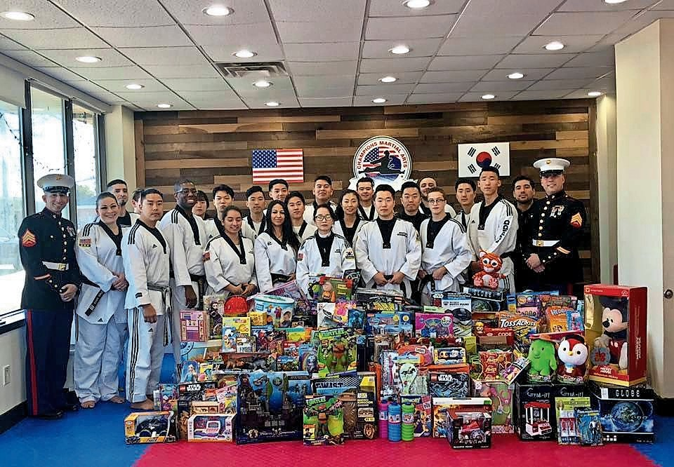 Champion Martial Arts in Oceanside collected and donated nearly 1,500 toys to the Nassau division of Marine Toys for Tots on Dec. 9.
