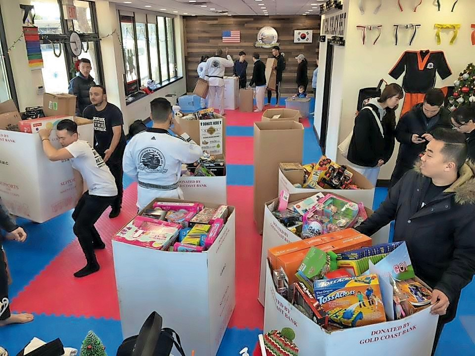 Students of Champion Martial Arts donated their time to fill boxes with toys to donate to children across Long Island.