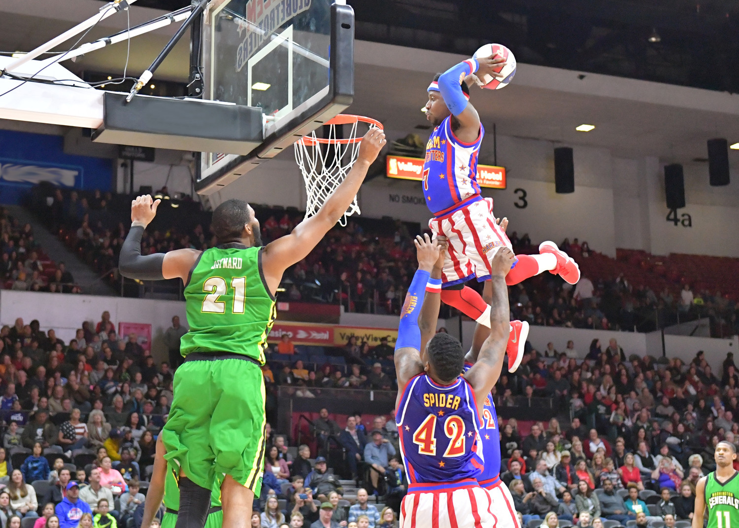 Guard Too Tall Hall has the distinction of being one of the shortest players in Globetrotters history at 5'2''; he continually wows the crowd with his signature moves.
