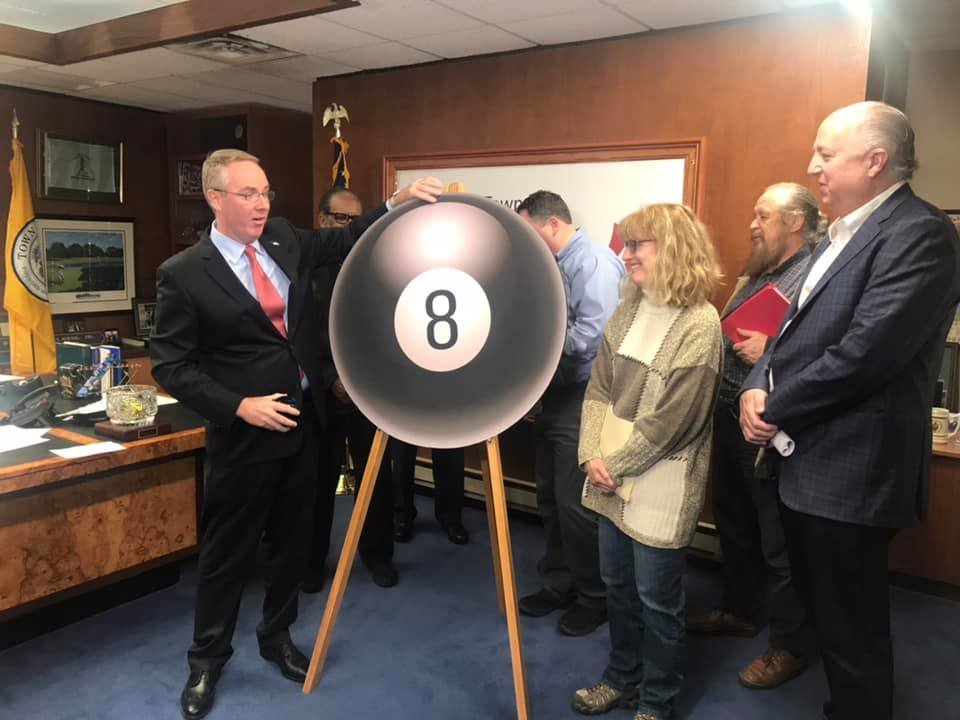 "Clavin, left, held a news conference on Dec. 4 criticizing the county property reassessment process and urging residents to join his Facebook group. Clavin made use of a cardboard ""Magic 8-Ball"" to mock county officials' answers to residents' questions."