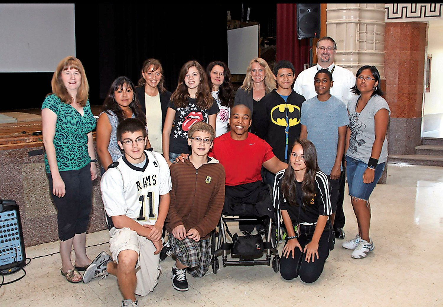 In 2012, Lee, top row, fifth from right, invited Paralympian wrestler and motivational speaker Rohan Murphy to speak to students at the high school.