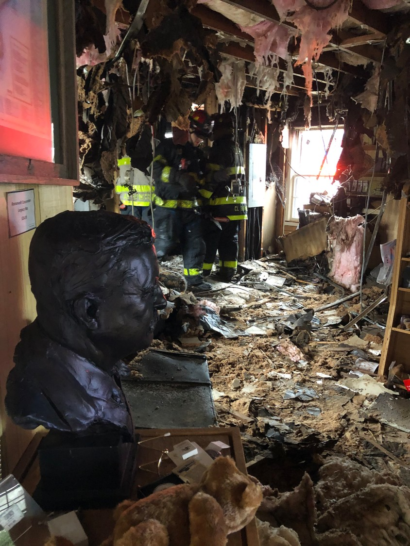 A bronze bust of Theodore Roosevelt and a teddy bear survived a fire that destroyed the Sagamore Hill Visitor Center on Christmas Eve morning.