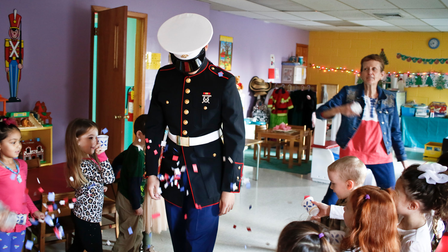 "Franklin Square Marine Daniel Artino was showered with confetti upon his return to Little Pebbles in East Rockaway. ""They were very enthusiastic,"" he said of the students."