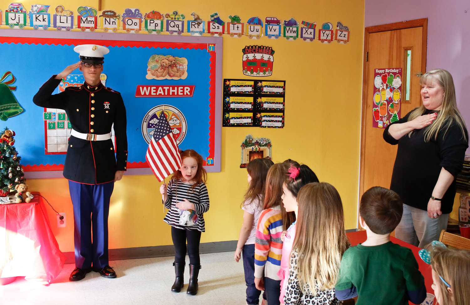 After completing boot camp, Franklin Square native Daniel Artino returned with great pomp to the pre school where his mother, Carol, far left, works and where he attended as a child.