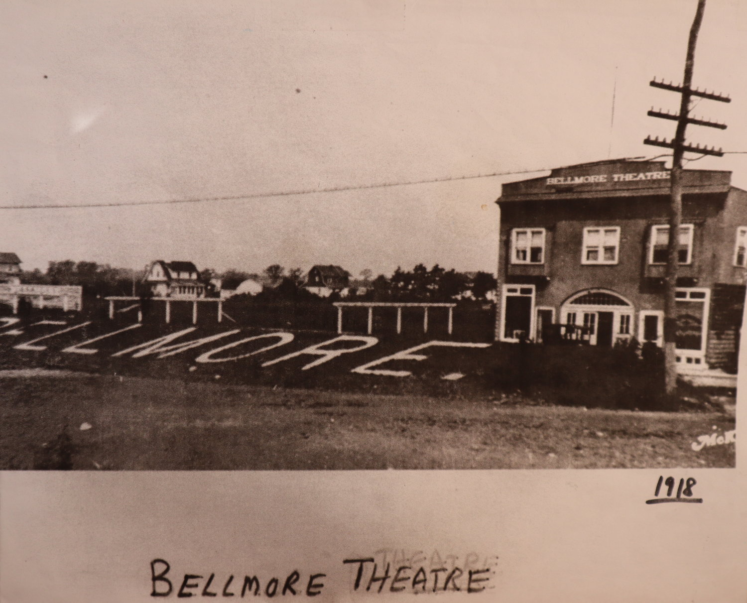 A photo from 1918 — when hitching posts were still available, and LIRR commuters identified the Bellmore stop by the massive letters painted on the grass — that can be seen in Bellmore Movies.