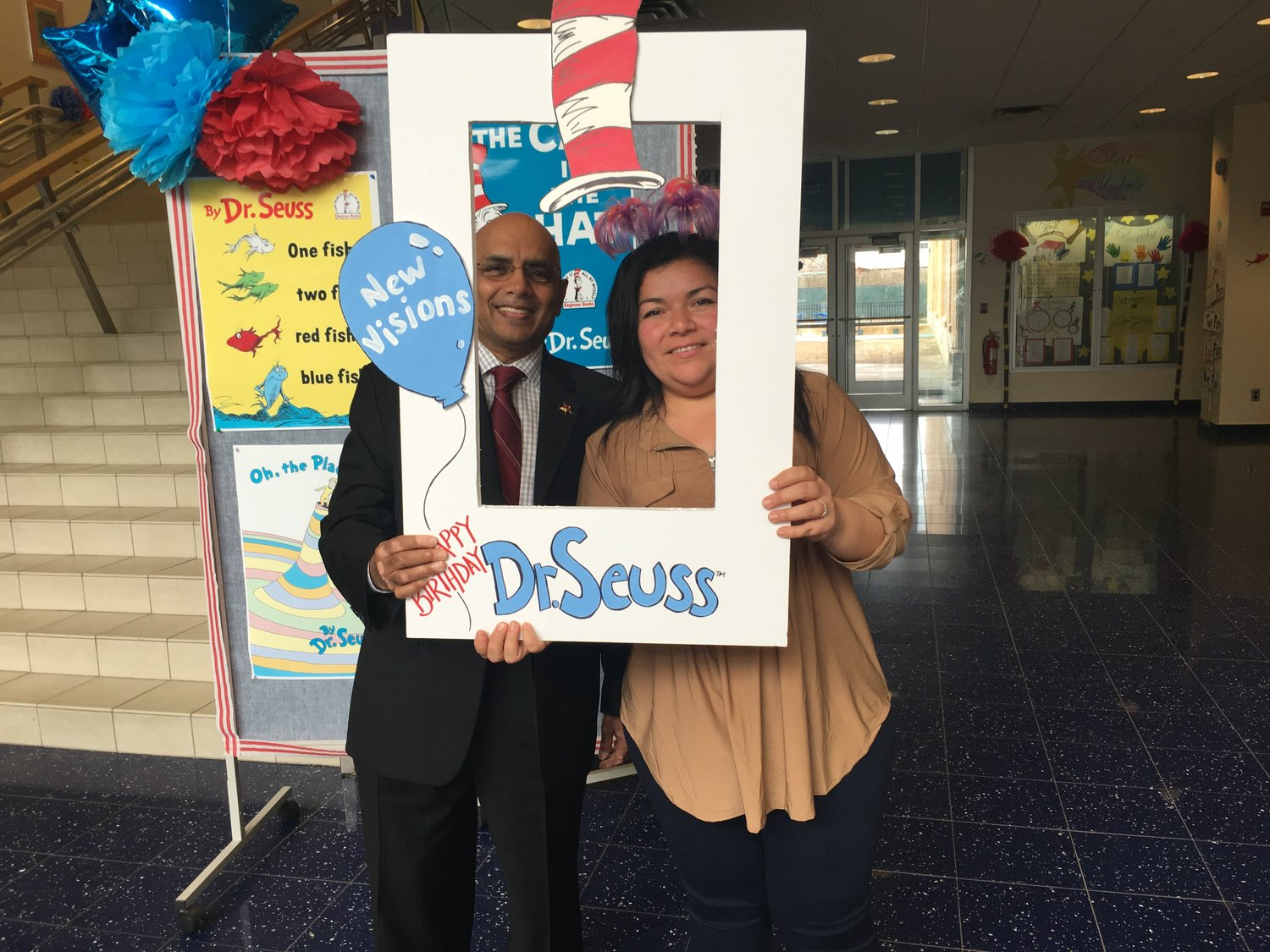 Freeport Public Schools superintendent, Dr. Kishore Kuncham, left, celebrated with Jordan-Awalom Dr. Seuss Day with Jordan-Awalom.
