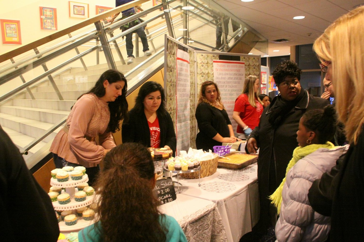Maria Jordan-Awalom, second from left, helped out during a school bake sale.