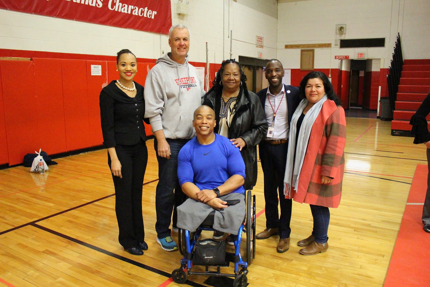 Jordan-Awalom, right, along with Freeport School District Board members pictured with American paralympian and motivational speaker Rohan Murphy.