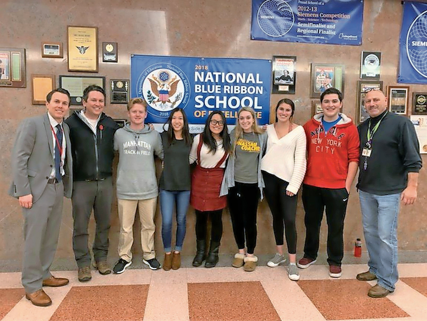 Patrick Walsh, left, with Todd Russo, to his left, and Herb Weiss, far right, who lead South Side's science research program, joined Regeneron applicants Jack McGowan, Kellien Peritz, Samantha Ying, Avery Goldberg, Emma Sueiro and Connor Giovanniello.