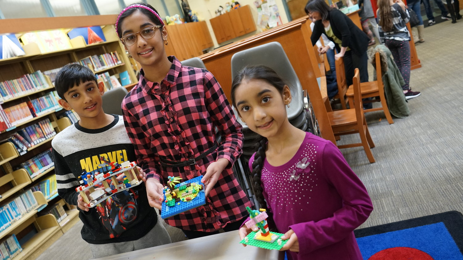 Arvind, Asha and Amberley Gajraj showed off their LEGO creations, which will be on display at the Henry Waldinger Memorial Library starting Jan. 6.