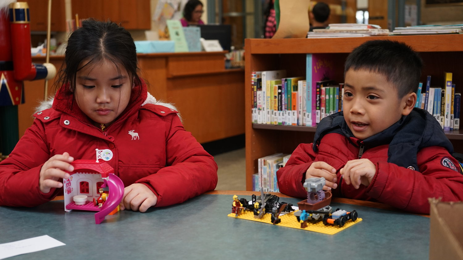 Angela Le, 8, built a playhouse and Christopher Le, 7, a battlefield.